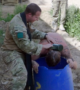 Padre Robin Richardson baptises a soldier in Afghanistan