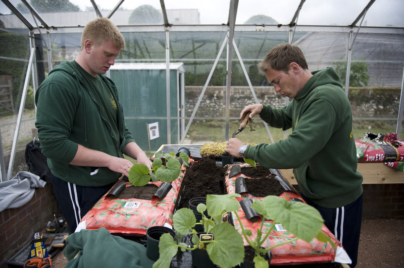 Royal Marines Aaron Moon from Wigan and Tristan Sykes from Norwich at work in the greenhouse of the new project at Headley Court