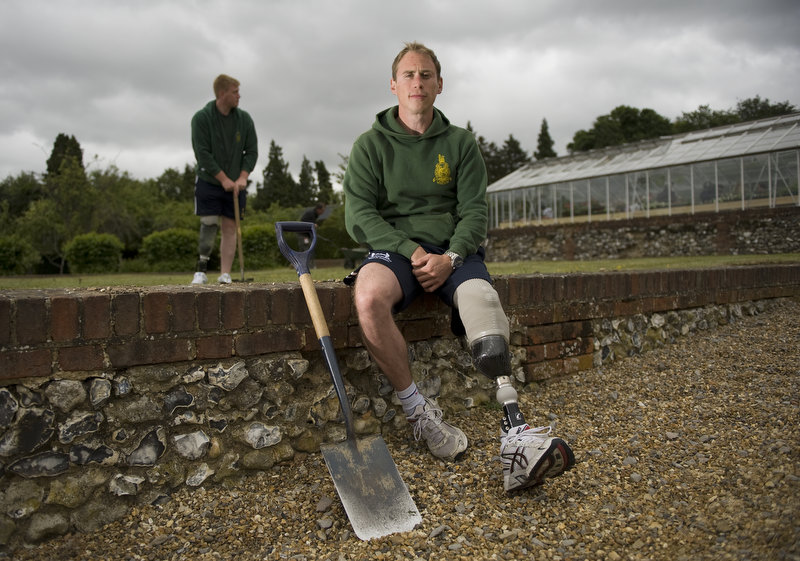 Marine Tristan Sykes, 30 from Norwich in Norfolk sits outside the new greenhouse at Headley Court