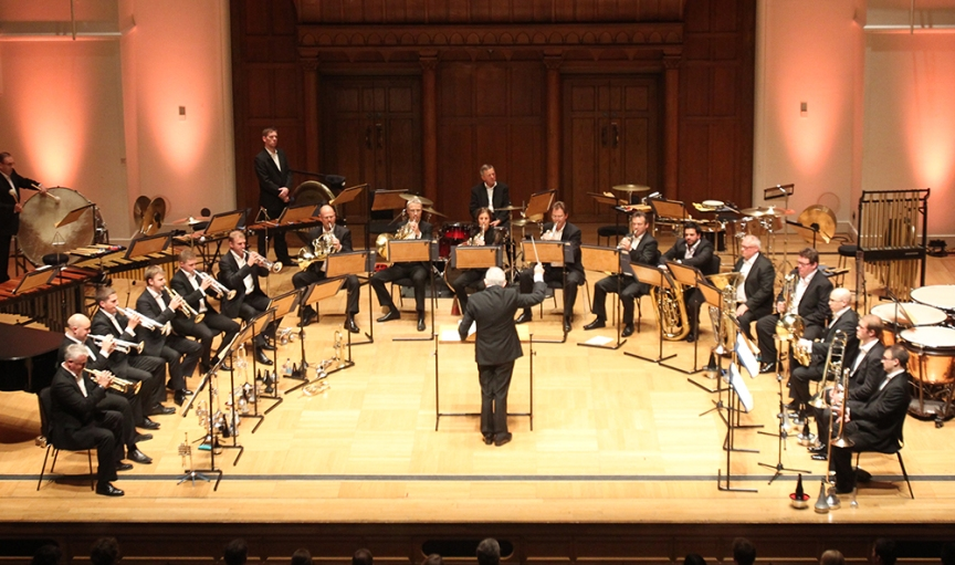 Lance Sergeant John Storey performing on the trombone with other brass players of the RPO