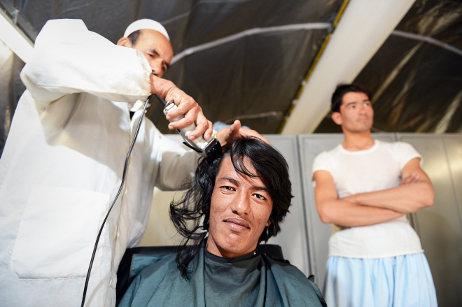 Officer cadets getting their hair cut upon arrival at the ANAOA