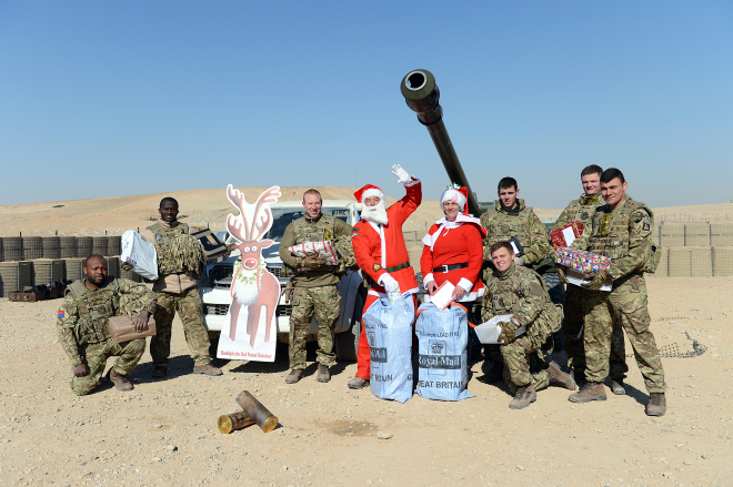 Santa delivers parcels to the troops in the 3rd Regiment, the Royal Horse Artillery